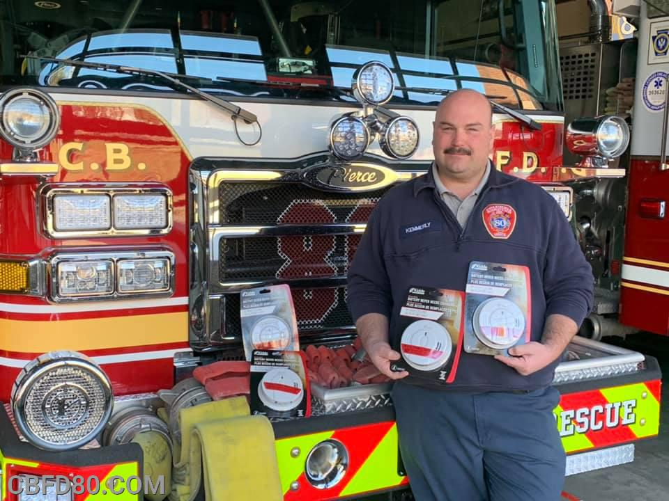 Chief Kemmerly with Smoke Detectors Donated by Columbia Life Network