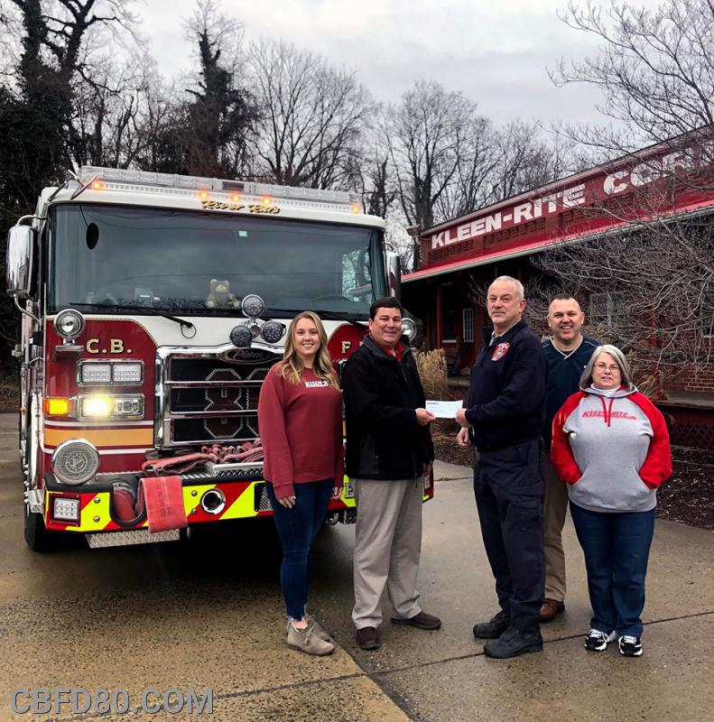 Assistant Chief Mike Zercher with Kleen-Rite Employees